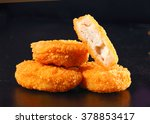 a pile of chicken nuggets... | Shutterstock . vector #378853417