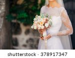 wedding bouquet in hands of the ... | Shutterstock . vector #378917347