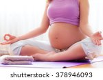 pregnancy yoga. young pregnant... | Shutterstock . vector #378946093