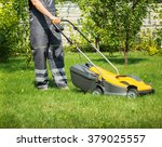 Young Man Gardener Using Lawn...