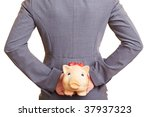 Businesswoman Hiding A Piggy...