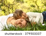 mom and her little daughter lie ... | Shutterstock . vector #379503337