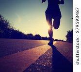 young fitness woman runner...   Shutterstock . vector #379593487