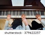 a music teacher with the pupil... | Shutterstock . vector #379622257
