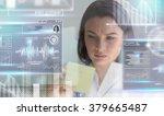 calm doctor touching a medical... | Shutterstock . vector #379665487
