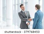 business partners handshake in... | Shutterstock . vector #379768453