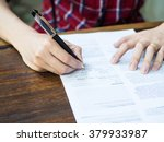 man sign a paper on desk | Shutterstock . vector #379933987