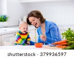 mother feeding child. first... | Shutterstock . vector #379936597