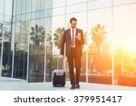 elegant businessman checking e... | Shutterstock . vector #379951417