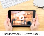 Small photo of Hand holding tablet with Video sharing on screen on wood table ,Internet marketing concept.