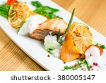 salmon steak with grilled... | Shutterstock . vector #380005147