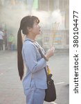 Small photo of Ho Chi Minh City, Vietnam - February 08, 2016: Vietnamese woman is praying in the Quoc Tu Pagoda during Lunar New Year celebrations in Ho Chi Minh City, Vietnam on February 08, 2016.