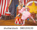 Little Girl In Pink Costume At...