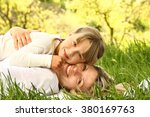 mom and her little daughter lie ... | Shutterstock . vector #380169763