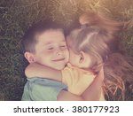 two young children are hugging... | Shutterstock . vector #380177923