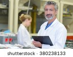 man in white coat holding... | Shutterstock . vector #380238133