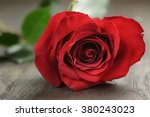 single red rose on wooden table ... | Shutterstock . vector #380243023