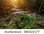 waterfall in a deep forest with ... | Shutterstock . vector #380323177