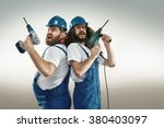 Stock photo funny portrait of two cheerful craftsmen 380403097
