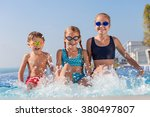 happy children  playing on the... | Shutterstock . vector #380497807