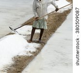 Small photo of Agriculturist is harvesting salt farm, Pondicherry arera