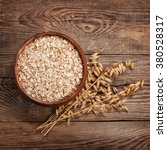 oat flakes on the old board....   Shutterstock . vector #380528317