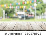 empty wooden table with blurred ... | Shutterstock . vector #380678923