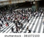 crowds of people cross a large... | Shutterstock . vector #381072103