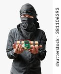 Small photo of Terrorist holds dynamite bomb in hand. Isolated on white background.