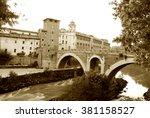 Small photo of A glimpse of the island Tiberina and the river Tiber edella its architecture - Rome - Italy