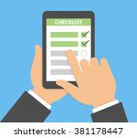 finger pointing to checklist on ... | Shutterstock .eps vector #381178447