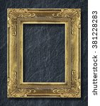 gold frame on black slate... | Shutterstock . vector #381228283
