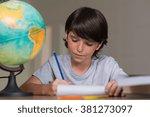 closeup of little boy doing... | Shutterstock . vector #381273097