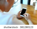 man holding smartphone with... | Shutterstock . vector #381280123
