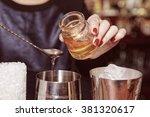 bartender is adding honey to... | Shutterstock . vector #381320617