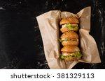 Three Burgers On A Dark...