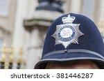 london police hat badge  closeup | Shutterstock . vector #381446287