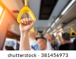 people hand holding handle on... | Shutterstock . vector #381456973