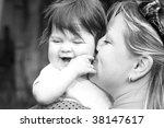 mother holding her children....   Shutterstock . vector #38147617
