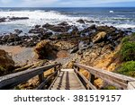 stairs leading to a sandy beach ... | Shutterstock . vector #381519157