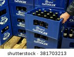 Small photo of GERMANY - DECEMBER 21, 2015: Oettinger beer crates in a Hypermarket. Oettinger has been Germany's best selling beer brand. Various German beers are discredited because of poison residues in beer.