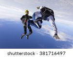 a girl and a guy skydivers... | Shutterstock . vector #381716497