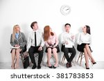 Young People Sitting On A...