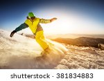 snowboarder rides on the slope... | Shutterstock . vector #381834883