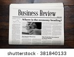Business Newspaper On Wooden...