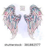 patterned wings on the grunge... | Shutterstock .eps vector #381882577