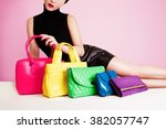 Woman With Many Colorful Bags...