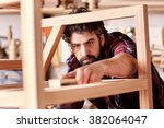 portrait of a serious craftsman ... | Shutterstock . vector #382064047