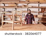portrait of a smiling craftsman ... | Shutterstock . vector #382064077