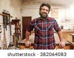 portrait of a smiling craftsman ... | Shutterstock . vector #382064083